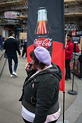 A passer-by tastes a sample of the new Zero Sugar Sugar Free Coca-Cola drinks, given out in Piccadilly Circus, on 16th April 2018, in London, England.