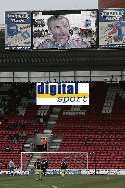 Photo: Lee Earle.<br /> Southampton v Derby County. Coca Cola Championship. 04/02/2006. Saint's head coach George Burley on one of the big screens before kick-off.