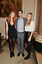 Left to right, ZOE HUNTER, JOAQUIN LASSALA and MOON SAKER at the annual Royal Academy of Art Summer Party held at Burlington House, Piccadilly, London on 4th June 2014.