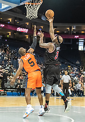 July 6, 2018 - Oakland, CA, U.S. - OAKLAND, CA - JULY 06: Al Harrington (3) co-captain of Trilogy goes up behind Baron Davis (5) co-captain of 3's Company for the basket during game 1 in week three of the BIG3 3-on-3 basketball league on Friday, July 6, 2018 at the Oracle Arena in Oakland, CA  (Photo by Douglas Stringer/Icon Sportswire) (Credit Image: © Douglas Stringer/Icon SMI via ZUMA Press)
