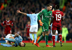 Manchester City's Nicolas Otamendi (left) goes down from a challenge as Manchester City goalkeeper Ederson (centre) confronts Liverpool's Sadio Mane during the UEFA Champions League, Quarter Final at the Etihad Stadium, Manchester.