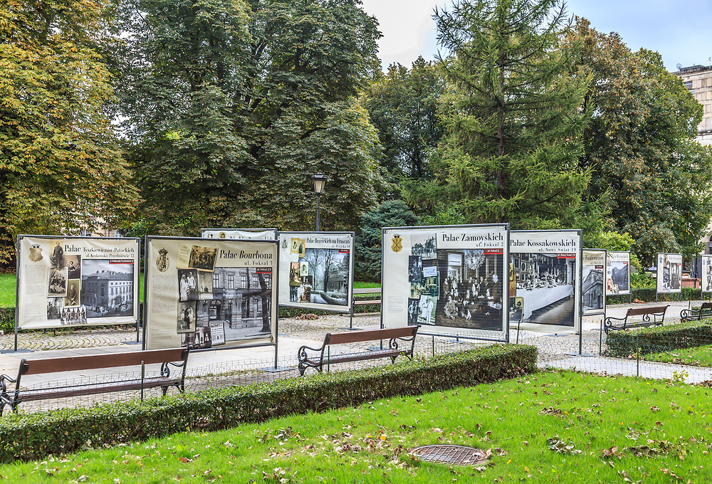 """Exhibition that represent destroyed families and palaces   in Warsaw, Poland.  The text """"Nie Istnieje"""" - doesn't exist - attached to many mansion signs tells the sad story of the families who inhabited them."""