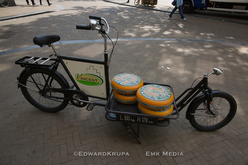 A cheese delivery bike in Amsterdam with wheels of Beemster cheese in a special hold in Amsterdam.