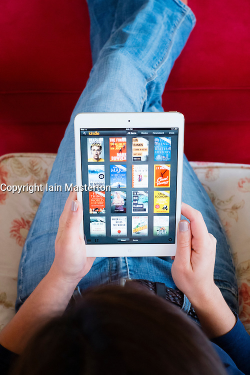 Using Amazon Kindle ebook library on an iPad mini tablet computer
