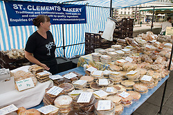 Stallholder on the St,Clements Bakery stall; selling freshly baked local produce at an outdoor Farmer's market,