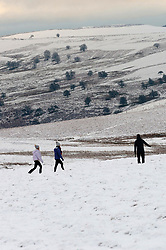 © Licensed to London News Pictures. 28/12/2020. Builth Wells, Powys, Wales, UK.  People go for a walk in a wintry landscape on the Mynydd Epynt moorland near Builth Wells in Powys, Wales, UK. Photo credit: Graham M. Lawrence/LNP