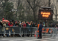 "March 16, 2013 - New York, NY, U.S. - A sign says ""PARADE OVER"" at the end of the parade route of the 252nd annual NYC St. Patrick's Day Parade, by the Metropolitan Museum of Art. Thousands of marchers show their Irish pride, as they march up Fifth Avenue, and over a million people, often in green and orange, watch and celebrate. The snow that begaan to fall in Manhattan after the parade started didn't stop the celebrations."