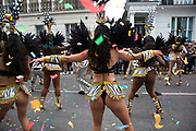 Brazilian dancers take part in the parade on Monday 28th August 2016 at Notting Hill Carnival in West London. A celebration of West Indian / Caribbean culture and Europes largest street party, festival and parade. Revellers come in their hundreds of thousands to have fun, dance, drink and let go in the brilliant atmosphere. It is led by members of the West Indian / Caribbean community, particularly the Trinidadian and Tobagonian British population, many of whom have lived in the area since the 1950s. The carnival has attracted up to 2 million people in the past and centres around a parade of floats, dancers and sound systems.