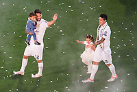 Real Madrid's players Isco and James with his kids during the celebration of the victory of the Real Madrid Champions League at Santiago Bernabeu in Madrid. May 29. 2016. (ALTERPHOTOS/Borja B.Hojas)