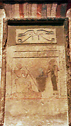 Stele of Imenyseneb (2123-2040 BC), Egyptian painted limestone section from a Stela (stele). Imenyseneb is served by his wife under the protective symbol of the Wedjet eye. Imenyseneb was chief of expeditions for the royal court of the Pharaoh.