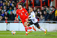 Wales forward forward Tyler Roberts on the ball during the Friendly European Championship warm up match between Wales and Trinidad and Tobago at the Racecourse Ground, Wrexham, United Kingdom on 20 March 2019.
