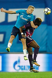 August 24, 2017 - Saint Petersburg, Russia - Igor Smolnikov (L) of FC Zenit Saint Petersburg and Jean-Christophe Bahebeck of FC Utrecht vie for the ball during the UEFA Europa League play-off round second leg match between FC Zenit St. Petersburg and FC Utrecht at Saint Petersburg Stadium on August 24, 2017 in Saint Petersburg, Russia. (Credit Image: © Mike Kireev/NurPhoto via ZUMA Press)