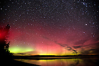 The aurora borealis spreads across the night scy over Shoshone Lake last week in Yellowstone National Park. The aurora is typically seen in regions closer to the poles but is occasionally visible as south as Jackson Hole and beyond during times of increased solar flare activity.