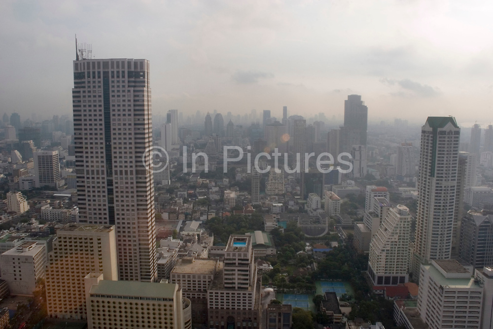 Bangkok skyline viewed from the 54th floor of the Lebua Hotel at State Tower in Silom district in the morning. Cars run through the city on the expressways below, and Bangkok's status as an highrise giant of Asia is unquestionable.