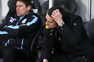 Remi Garde  the Aston Villa manager scratches his head as he looks on from the dugout.  Barclays Premier league match, Swansea city v Aston Villa at the Liberty Stadium in Swansea, South Wales on Saturday 19th March 2016.<br /> pic by  Andrew Orchard, Andrew Orchard sports photography.