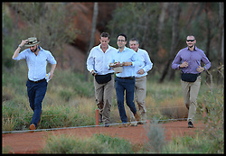 Press Officer Nick Loughran (left, Hat), Private Secretary Miguel Head (glases hat in hand)and protection officers run to get out of the way of the media as The Duke and Duchess of Cambridge visit Uluru (Ayers Rock) Uluru, Australia, on day 16 of their Royal Tour of New Zealand and Australia, Tuesday, 22nd April 2014. Picture by Andrew Parsons / i-Images