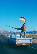 Dave Thomas drives his 33-foot-long (10M) Albertasaur to California past the Zia Pueblo Reservation in Arizona.
