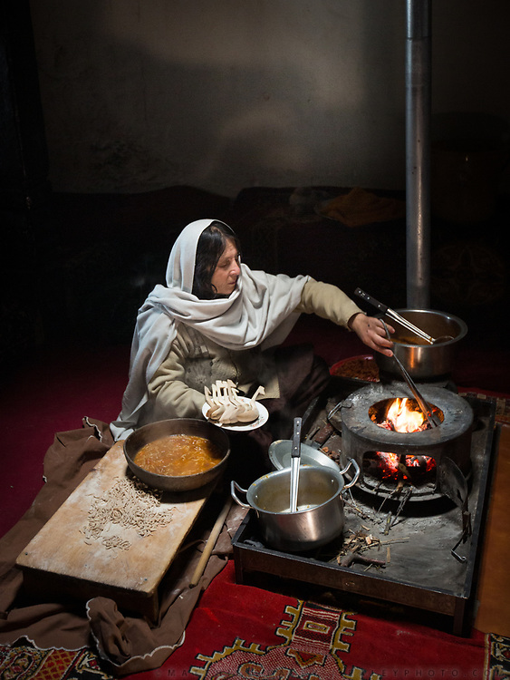 Making traditional dish of Apricot soup called Haneetze Doudo. In the old village of Karimabad, Hunza province.
