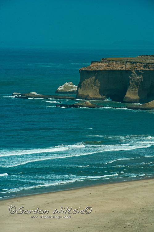 Waves break along the Pacific Ocean coast near Half Moon Bay, California.