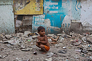 Tehkhand Slum, Delhi, India.  Indian slums are characterized as a run-down area of a city with substandard housing, squalor and lacking in security.  They are home to increasing numbers of people and families who are usually very poor or socially disadvantaged. Most slums lack clean water, sanitation and other basic services, and as such they pose a serious threat to public health as infectious diseases are able to spread easily, such as Tuberculosis (TB) and cholera.
