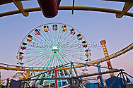 Santa Monica Pier amusement park.  Taken from a low angle, the shapes of the different rides combine to create a fun image.