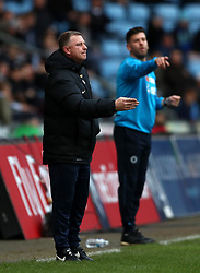 Coventry City manager Mark Robins on the touchline