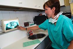 NHS dentist examines an x-ray Bradford Yorkshire UK