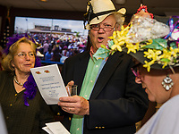 """Leslie Manning and Douglas and Lisa Richards sing """"My Old Kentucky Home"""" prior to the start of the Kentucky Derby Saturday evening at the Beane Center to benefit the Unitarian Universalist Society of Laconia.  (Karen Bobotas/for the Laconia Daily Sun)"""