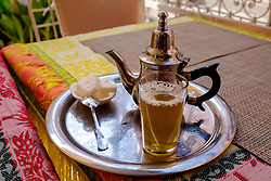 A glass of traditional mint tea served in a cafe in the medina - Marrakech, Morocco, North Africa<br /> <br /> <br /> <br /> (c) Andrew Wilson | Edinburgh Elite media