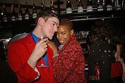 Tolula Adeyemi and James Main, MILLA JOVOVICH, CARMEN HAWK & HARVEY NICHOLS CELEBRATE THE LAUNCH OF JOVOVICH-HAWK. FIFTH FLOOR CAFƒ. HARVEY NICHOLS. london.  27 April 2006. ONE TIME USE ONLY - DO NOT ARCHIVE  © Copyright Photograph by Dafydd Jones 66 Stockwell Park Rd. London SW9 0DA Tel 020 7733 0108 www.dafjones.com