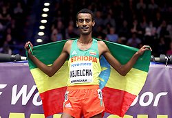 Ethiopia's Yomif Kejelcha celebrates winning gold in the Men's 3000 Metres final during day four of the 2018 IAAF Indoor World Championships at The Arena Birmingham.