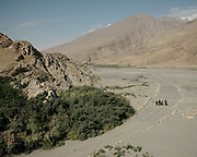 Two teachers and 3 young students on their daily 45 minutes walk to go from their village to the school in the village next door. <br />