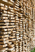 Beech planks stacked for seasoning at logging timber plant in Valle del Roncal in Pyrenees, Northern Spain