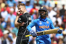 New Zealand's Jimmy Neesham (right) celebrates after taking the wicket of India's Dinesh Karthik (right) during the ICC Cricket World Cup Warm up match at The Oval, London.