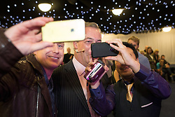 "© Licensed to London News Pictures . 30/11/2015 . Leeds , UK . People take selfies with NIGEL FARAGE before he addresses a "" Say No to the EU "" event at the Leeds United's ground at Elland Road . Photo credit: Joel Goodman/LNP"