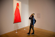 """Japan Tokyo - A woman look at the photography of Halim Al Karim for the """"Arab express"""" contemporay exhibition  in the Mori art center in roppongi. - 2012"""