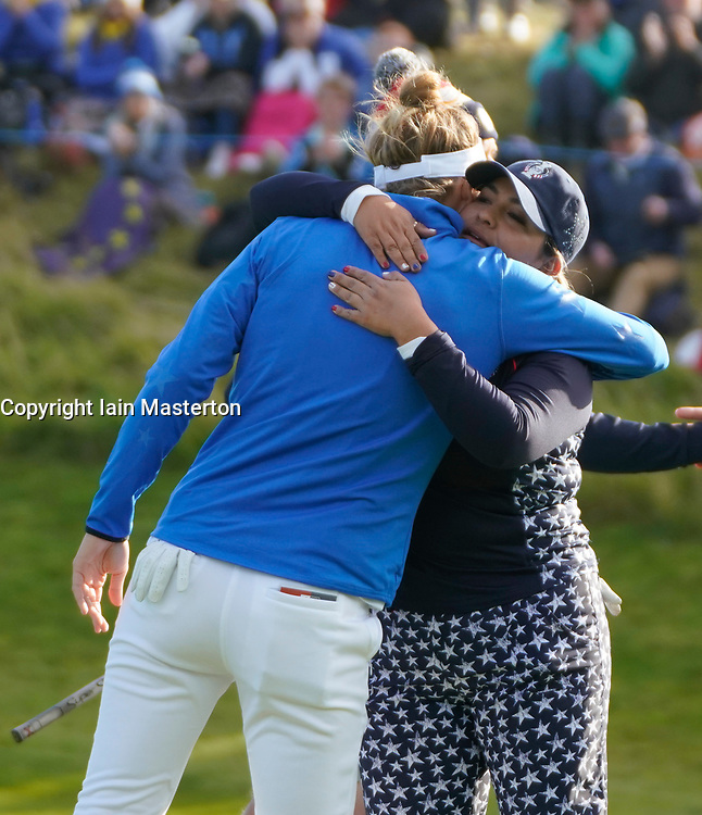 Auchterarder, Scotland, UK. 15 September 2019. Sunday final day at 2019 Solheim Cup on Centenary Course at Gleneagles. Pictured; Lizette Salas (r) of USA commiserates with Anne Van Dam of Europe after winning match on the last hole.  Iain Masterton/Alamy Live News