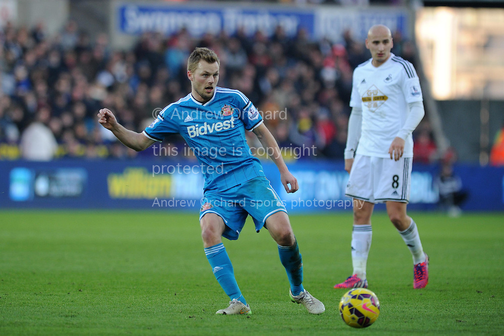 Sebastian Larsson of Sunderland in action.  Barclays premier league match, Swansea city v Sunderland at the Liberty stadium in Swansea, South Wales on Saturday 7th Feb 2015.<br /> pic by Andrew Orchard, Andrew Orchard sports photography.