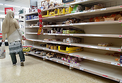 © Licensed to London News Pictures. 11/10/2021. London, UK. A shopper walks past nearly empty shelves of bakery products in Sainsbury's, north London. This is amid fears of food shortages leading up to Christmas, due to labour shortages, following Brexit. Leading supermarkets may start rationing certain items ahead of Christmas. Photo credit: Dinendra Haria/LNP