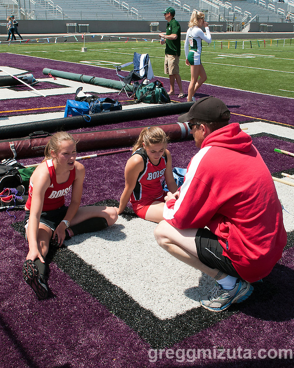 Boise pole vault coach Asa Nims talks to his vaulters, Desdemona Weigel and Emma Bellan, during the 5A Idaho Track and Field Championships on May 18, 2012 at Rocky Mountain High School, Meridian, Idaho.