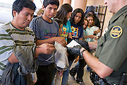 05 OCTOBER 2005 - DOUGLAS, AZ: US Border Patrol Agents process illegal immgrants originally from Mexico apprehended near Douglas, AZ. Apprehensions of illegal immigrants in the Douglas area are down significantly in the last 18 months. In 2003, the Border Patrol apprehended an average of 1,500 people a day in and around Douglas. In September and October 2005 they are apprehending only about 150 - 200 people a day.  PHOTO BY JACK KURTZ