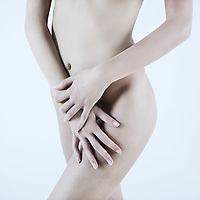 detail studio shot picture of a young beautiful breast naked caucasian woman