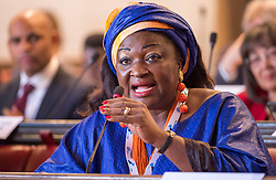 © Licensed to London News Pictures. 22/10/2018. Bristol, UK. Global Parliament of Mayors Annual Summit, 21-23 October 2018, at Bristol City Hall. Picture of CELESTINE KETCHA COURTES, Mayor of Bangangté, Cameroon, taking part in the plenary session on harnessing the power of migration. The Global Parliament of Mayors 2018 is the biggest and most ambitious Annual Summit to date. GPM Bristol 2018 will host up to 100 global mayors for an action-focused summit that addresses some of the biggest challenges facing today's world cities. GPM Bristol 2018's theme, Empowering Cities as Drivers of Change, will focus minds on global governance and the urgent need for the influence, expertise and leadership of cities to be felt as international policy is shaped. GPM Bristol 2018 will provide mayoral delegates with a global network of connections and a space to develop the collective city voice necessary to drive positive change. The programme will engage participants in decision-making, with panels, debate and voting on priority issues including migration and inclusion, urban security and health, and is a unique chance to influence decisions on the most pressing issues of our time. Photo credit: Simon Chapman/LNP
