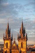 Towers of the Tyn Church located at Old Town Square during sundown.