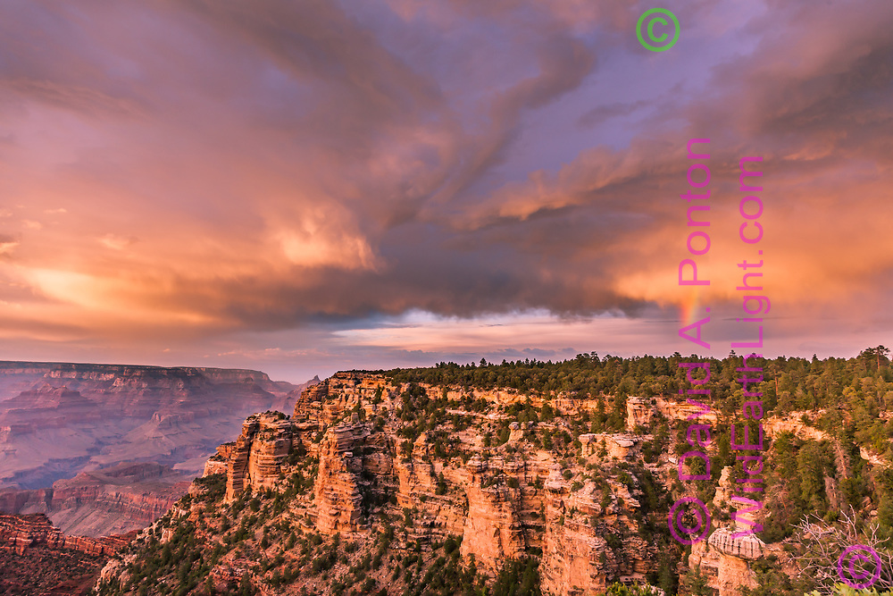 Stormy sky at sunset with rainbow over Yaki Point, south rim, Grand Canyon National Park, © David A. Ponton