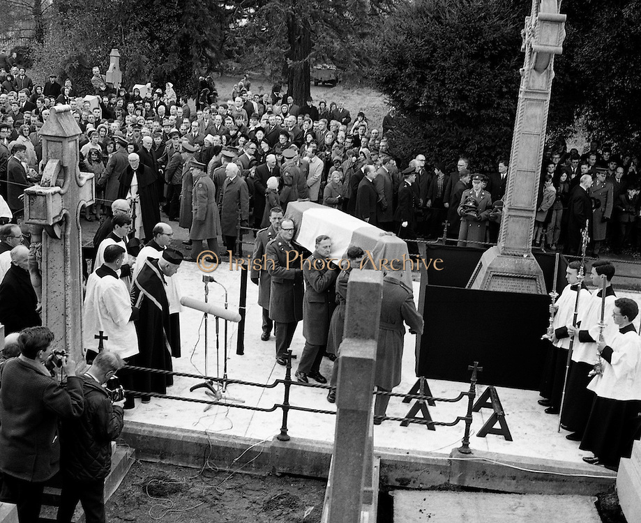 The funeral of Senator Margaret Mary Pearse, the Fianna Fáil politician and teacher and the sister of Patrick Pearse, one of the leaders of the 1916 Easter Rising..The silent crowds watch on as military honours are rendered on the arrival of the remains of Senator Pearse at Glasnevin Cemetery..09.11.1968