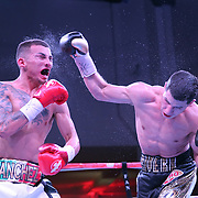 """Jean Carlos """"Chapito"""" Rivera punches Jason Sanchez during their championship boxing match for the WBO Junior World Title at the Hotel El Panama Convention Center on Wednesday, October 31, 2018 in Panama City, Panama. (Alex Menendez via AP)"""