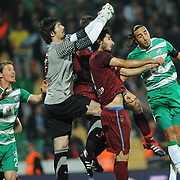 Bursaspor's Serdar AZIZ (L), Ibrahim OZTURK (R) and Trabzonspor's goalkeeper Tolga ZENGIN (2ndL), Halil ALTINTOP (2ndR) during their Turkish soccer superleague match Bursaspor between Trabzonspor at Ataturk Stadium in Bursa Turkey on Saturday, 22 October 2011. Photo by TURKPIX