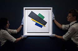 """© Licensed to London News Pictures. 19/06/2015. London, UK. Sotheby's staff show Kazimir Malevich's, """"Suprematism, 18th Construction"""" (est. £20-£30m), at Sotheby's Impressionist, Modern & Contemporary Art preview, ahead of the sale on 24 June 2015. Leading the sale are Kazimir Malevich's, """"Suprematism, 18th Construction"""" and Edouard Manet's """"Le Bar aux Folies-Bergère"""".  Photo credit : Stephen Chung/LNP"""