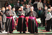Three bishops in front of St.Patrick's Cathedral review the parade and greet friends.